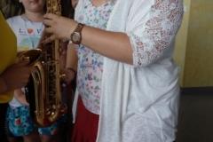 Kind mit Saxophon